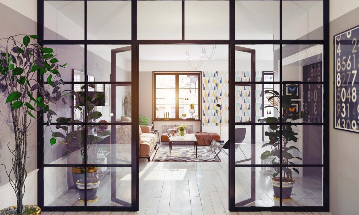 vetrata con infissi neri di design per separare il salotto